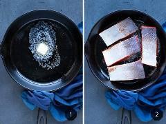 Salmón ennegrecido cocinado en una sartén de hierro fundido con mantequilla.