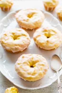 Donuts de limón al horno con glaseado de limón - ¡Saben como el pan de limón de Starbucks, pero en forma de donut (o mini muffin)! ¡Fácil, no hay receta para la batidora con un glaseado de limón agridulce que sea PERFECTO! ¡¡Los amantes del limón los adorarán !!