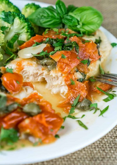 A truly wonderful dinner ready in 20 minutes! The tender and flaky Swai fillets with tomato sauce and capers are irresistible, easy to cook and very healthy. This recipe is a great way to use seasonal produce and herbs. From https://www.babaganosh.org