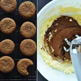 Estante de enfriamiento de galletas de jengibre y tazón de crema de mantequilla de naranja para entrar en ellas