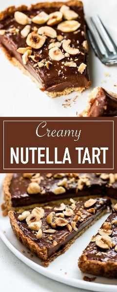 La mejor tarta de nutella con corteza de avellana. Cremoso y chocolate con un rico relleno de chocolate con avellanas.