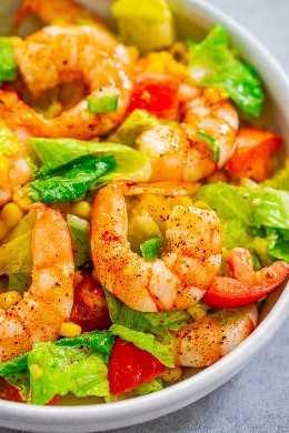 Salada de milho e camarão com limão e mel: camarão macio e macio, aninhado em uma salada crocante e tudo coberto com um irresistível molho de limão e mel. Salada fácil e saudável que está pronta em 10 minutos!