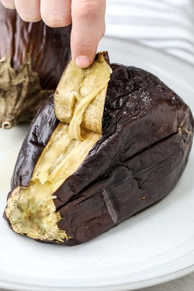 Peel the skin of the roasted eggplant to make slime ganoush
