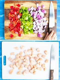 Pimientos, cebolla roja y pollo cortados en cubitos de 1 pulgada para mostrar cómo preparar una receta de pollo con piña.