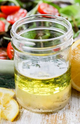 Ingredients for a simple layered lemon vinaigrette dressing recipe in a canning jar