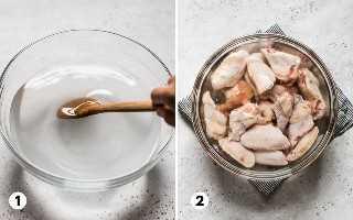 Asas de frango em uma tigela grande cheia de salmoura feita de água, sal e açúcar.