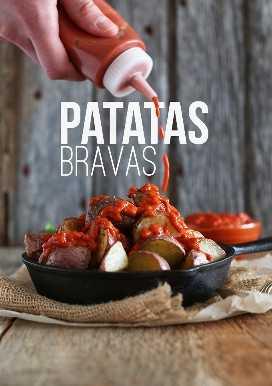Salsa de llovizna sobre las Patatas Bravas veganas sin gluten