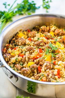 Sausage and Easy Peppers in a Skillet with Rice - Juicy sausage, crispy peppers, onions, and rice cook together in a skillet! Makes cleaning a breeze! Full of flavor and ready in 30 minutes!
