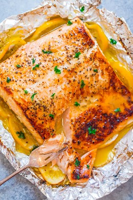 Garlic Butter Salmon in foil packet with sliced lemons