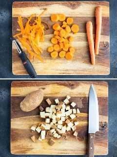 Zanahorias que se han pelado y cortado en rodajas y una papa grande que se ha cortado en cubos para una receta de curry saludable.