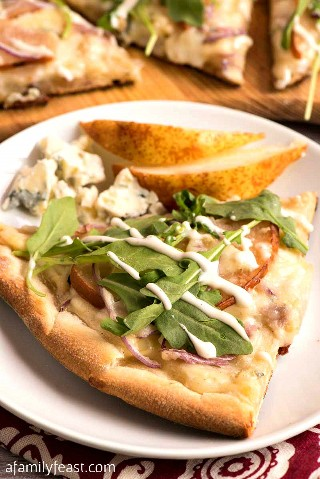 This pear and gorgonzola pizza with arugula and Ranch dressing is a unique pizza with a surprisingly delicious combination of flavors.