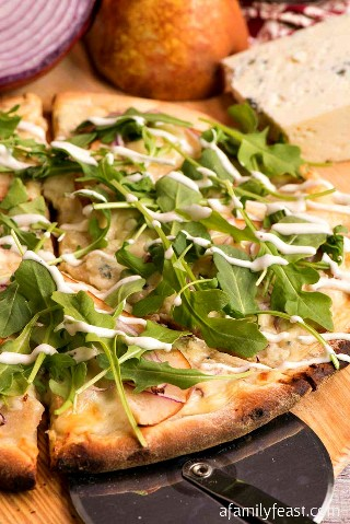 Pear and gorgonzola pizza with arugula and ranch dressing