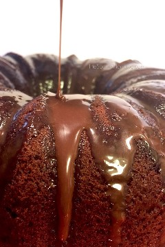 This double Hershey's Kiss chocolate cake is the PERFECT chocolate cake recipe! A bite will take you to chocolate heaven and crave more!