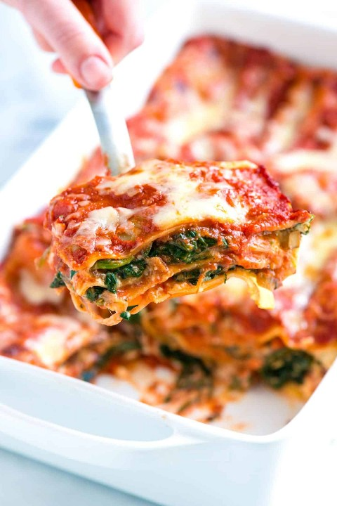 Easy spinach lasagna recipe with fresh spinach, savory mushrooms, light tomato sauce and cheeses.