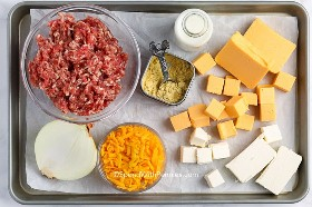Ingredients for sausage cheese sauce on a tray