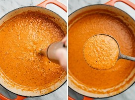 Una licuadora de inmersión que hace puré de salsa cremosa de tomate en un horno holandés; un cucharón lleno de salsa cremosa de pasta de tomate.