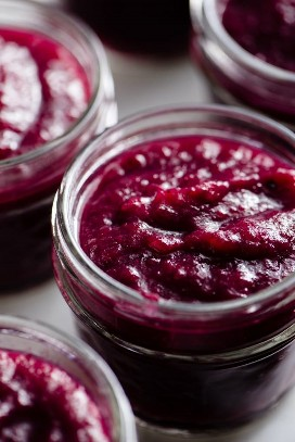 Homemade vanilla infused cranberry applesauce in a small glass jar.