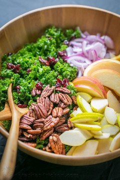 The Autumn Kale Salad Recipe is loaded with apples, pears, and walnuts. The lemon and honey dressing softens the kale and makes it so fresh. Easy, excellent kale salad! The | natashaskitchen.com