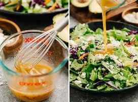 Vinaigrette in a glass mixing cups and vinaigrette poured over buffalo chicken salad.