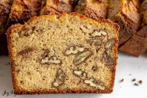Close up of crumb inside a piece of keto banana bread with walnuts