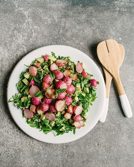 A great source of roasted radish salad with greens, farro, avocado, and an Italian dressing of mint green sauce.