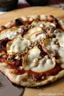 Cómo asar una pizza (¡es fácil!) ¡Además de un enlace a la mejor masa de pizza casera!
