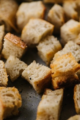 A close up view of baked sourdough croutons.