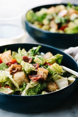 On the side, a bowl of BLT salad with avocado and hot bacon dressing.