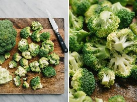 Chopped and chopped broccoli flowers on a cutting board.