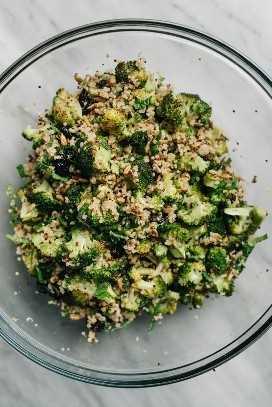 Quinoa and vegan broccoli salad in a glass bowl.
