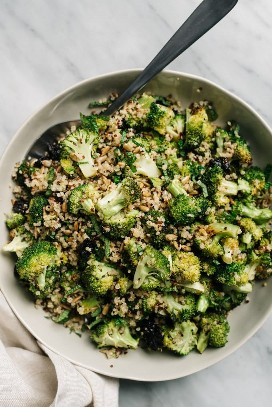 Vegan broccoli and quinoa salad with dried cherries and sunflower seeds in bowl.