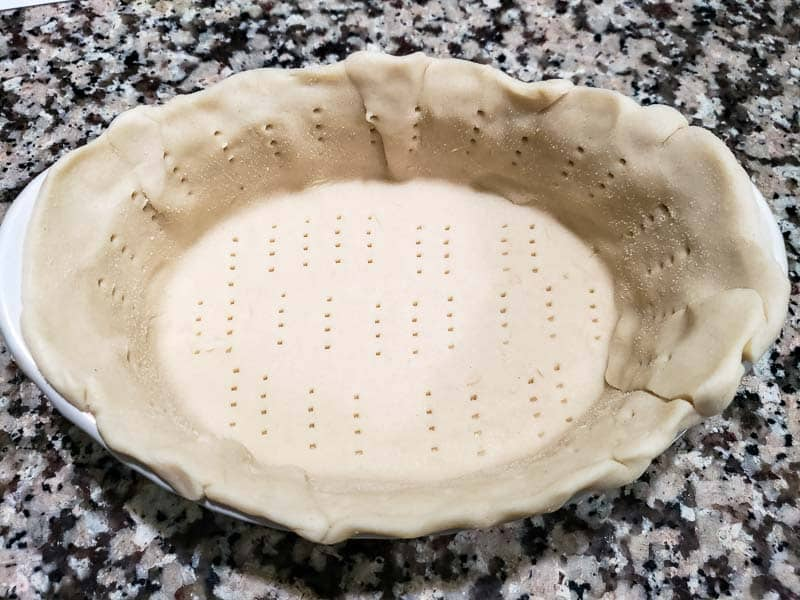 "casca adicionada ao prato e picada com um garfo ""srcset ="" https://juegoscocinarpasteleria.org/wp-content/uploads/2020/02/1582751884_26_Receta-de-quiche-de-alcachofa-con-espinacas-y-queso-para .jpg 800w, https://cdn1.zonacooks.com/wp-content/uploads/2019/07/Cheesy-Spinach-Artichoke-Quiche-Recipe-for-Two-2-500x375.jpg 500w, https: // cdn1 .zonacooks .com / wp-content / uploads / 2019/07 / Quiche de espinafre-alcachofra-quiche-receita-para-dois-2-768x576.jpg 768w, https://cdn1.zonacooks.com/wp-content/ uploads / 2019/07 / quiche de espinafre-alcachofra-receita-para-dois-2-320x240.jpg 320w, https://cdn1.zonacooks.com/wp-content/uploads/2019/07/Cheesy-Spinach -Artichoke -Quiche-Receita-para-Dois-2-480x360.jpg 480w, https://cdn1.zonacooks.com/wp-content/uploads/2019/07/Cheesy-Spinach-Artichoke-Quiche-Recipe-for- Dois- 2-720x540.jpg 720w, https://cdn1.zonacooks.com/wp-content/uploads/2019/07/Cheesy-Spinach-Artichoke-Quiche-Receita-para-Two-2-735x551.jpg 735w "" tamanhos = ""(largura máxima: 800 px) 100 vw, 800 px"