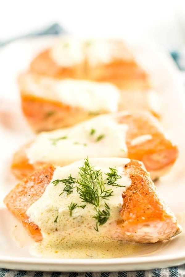 Salmon with creamy lemon dill sauce (Keto) on a white tray