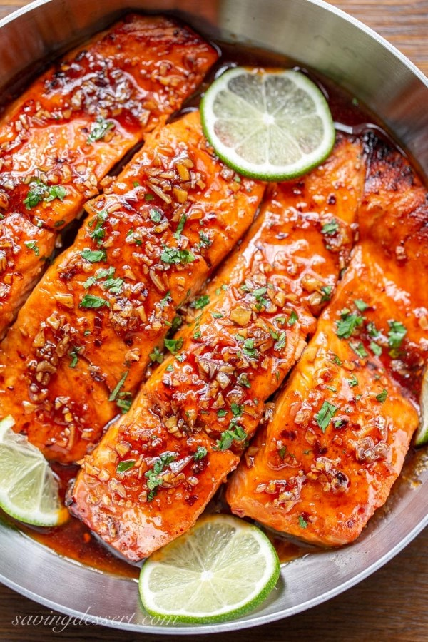 Salmon recipe glazed with spicy honey in a frying pan