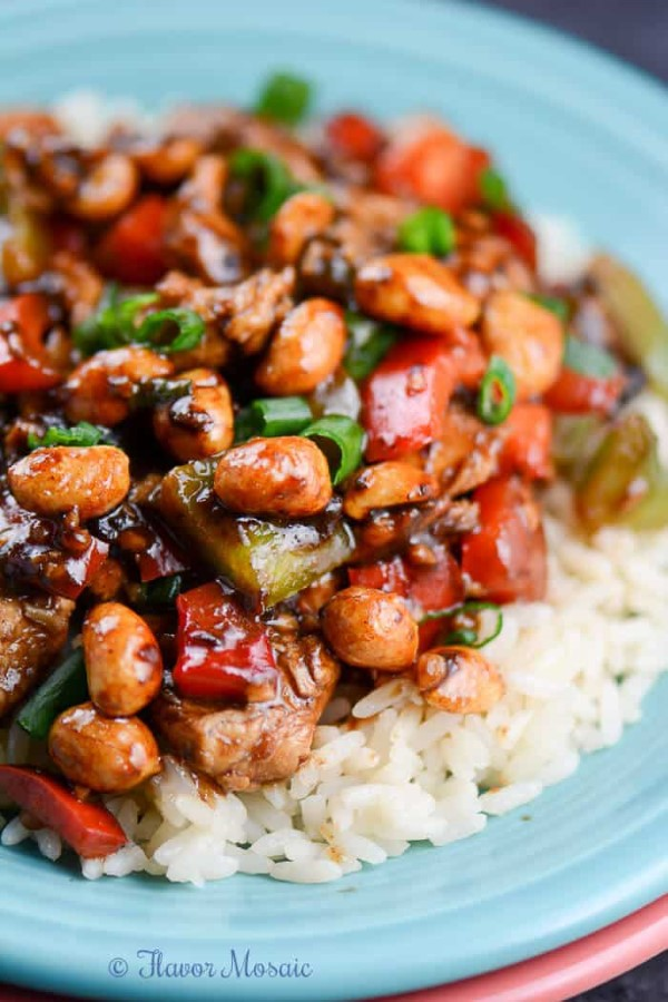 Easy recipe for chicken Kung Pao over rice on a blue plate