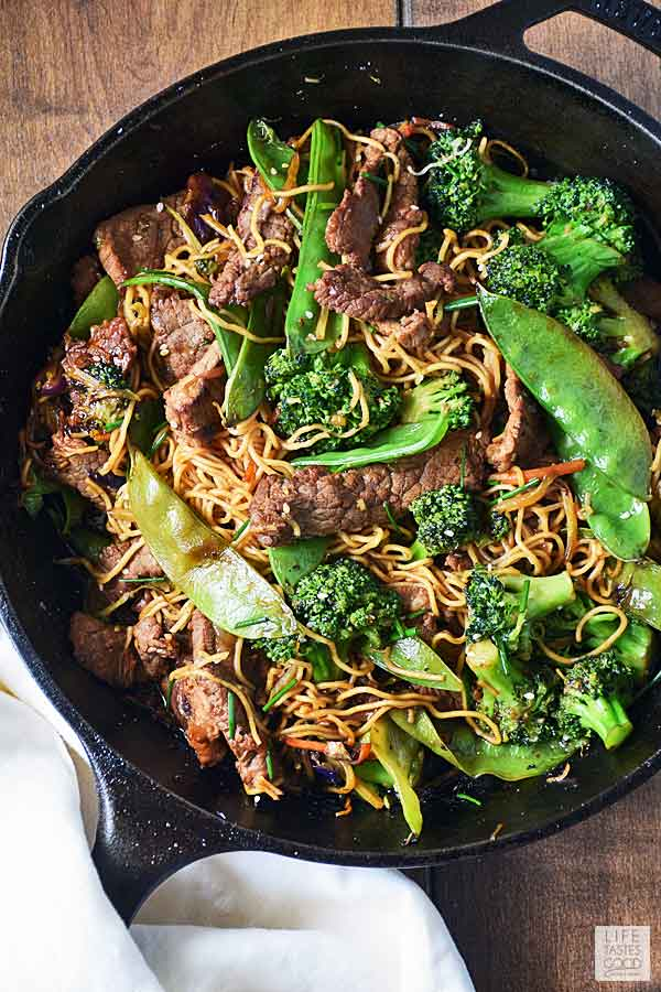 Sauteed beef with noodles in a cast iron skillet