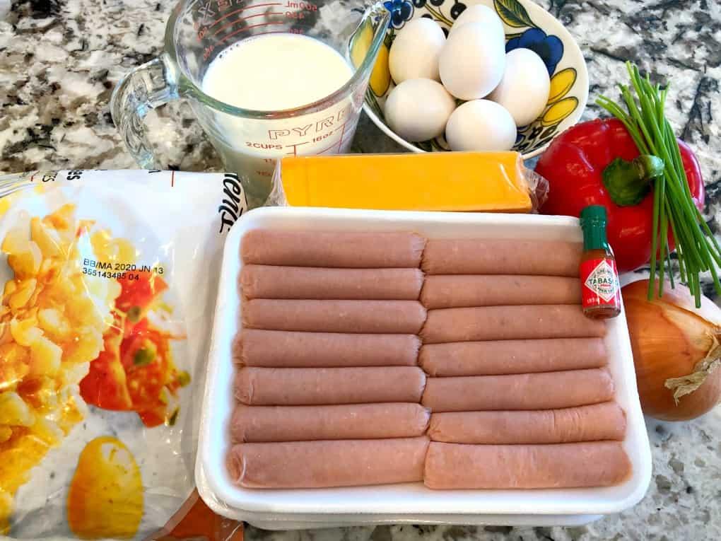 Salchicha de pavo, huevos, leche, queso, pimiento rojo, cebolla, tabasco, croquetas de patata