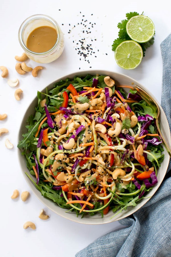 Thai zucchini noodle pad salad with sesame dressing and cashew nut in bowl