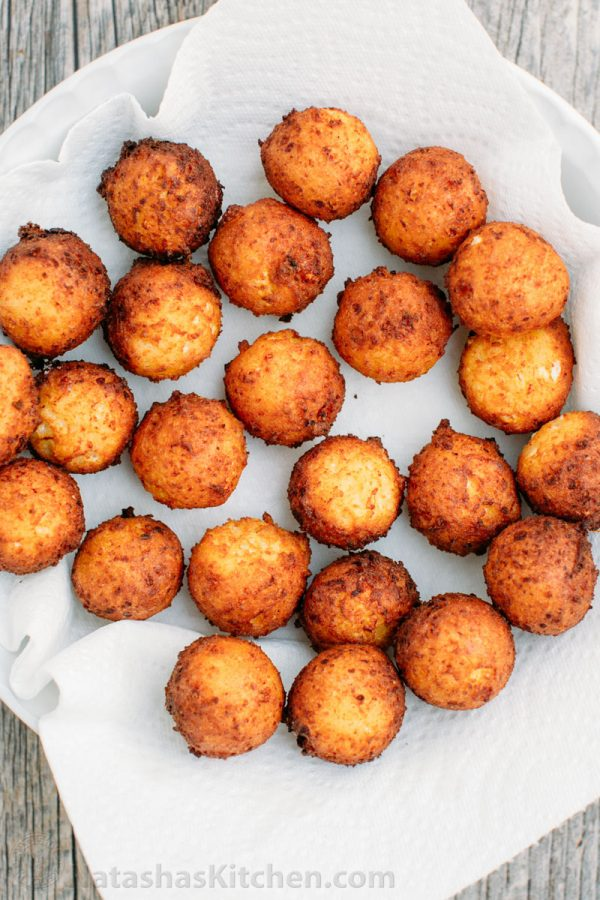 Billowy soft and slightly sweet Donut Holes (Russian Ponchiki). These donut holes are made with cheese giving them an unforgettable flavor. Easy donut recipe!