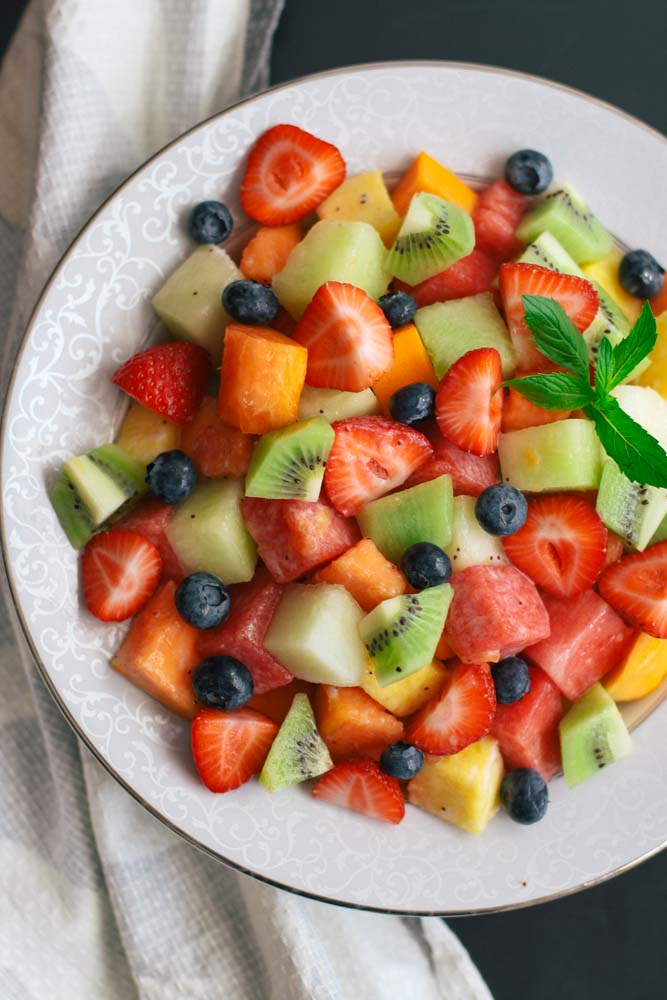 This recipe is for a refreshing fruit salad with poppy seed and coconut lime dressing. You can use any fruit you want and prepare it in 5 minutes!