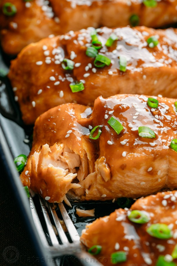 Flaked teriyaki salmon to check if it is ready when checking how long the salmon is baked