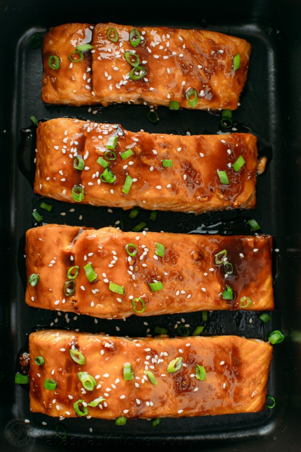 Teriyaki glazed salmon arranged in serving platter with service suggestion for teriyaki salmon