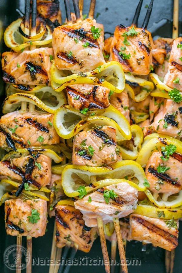 Easy grilled salmon skewers with garlic and dijon. Juicy with an amazing flavor and takes less than 30 minutes ~ HOLD! The | natashaskitchen.com
