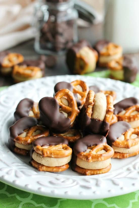 Peanut butter balls turn into pretzel bites for an addictive salty treat! Perfect for parties or Christmas gifts!