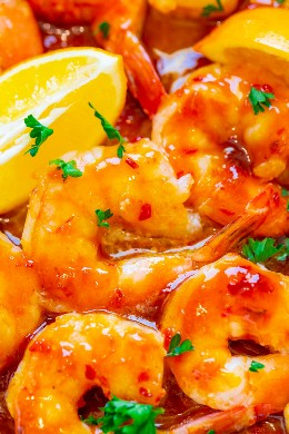10 Minute Orange Chili Shrimp - Sweet and spicy Asian-inspired orange chili sauce is PERFECT on these juicy, large shrimp! An EASY and healthy recipe that is sure to IMPRESS and will be ready in 10 minutes!