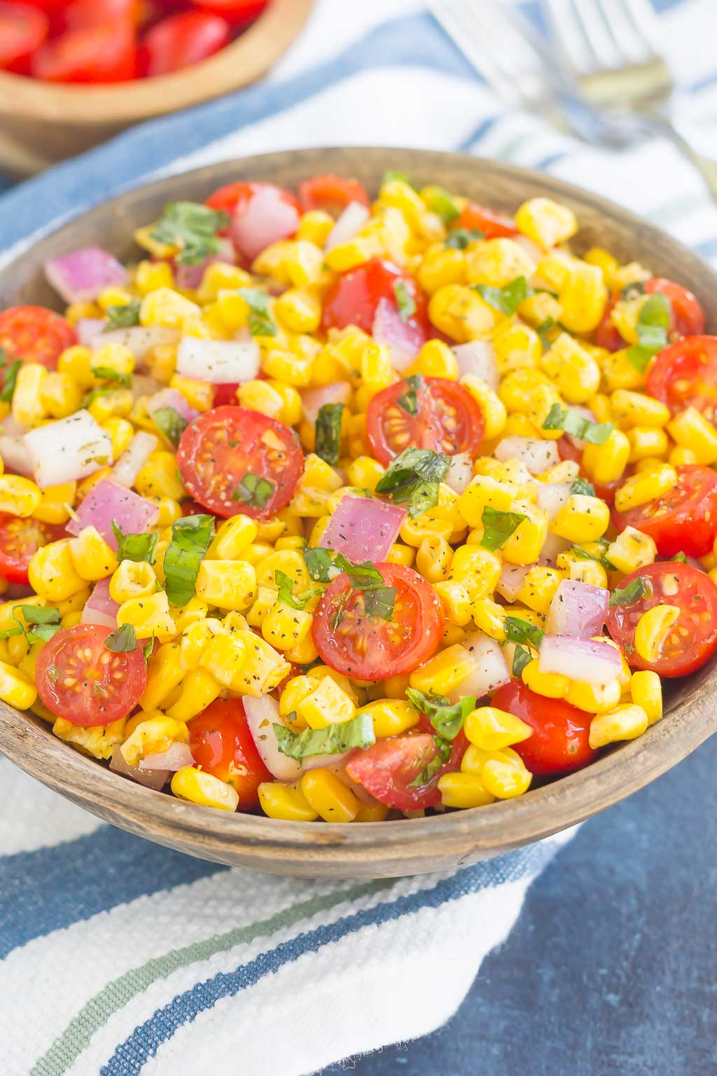 With fresh corn cut straight from the cob, cherry tomatoes, spices and a light dressing, this corn and tomato salad is perfect for a summer lunch or dinner! # corn #cornsalad #tomato #tomatosalad #corntomatosalad #salad #saladrecipe #summersalad