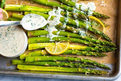 This recipe for roasted asparagus is a simple and quick accompaniment. The asparagus is perfectly tender with slightly crisp tips.