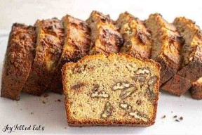 a slice of keto banana bread with walnuts leaning on more slices