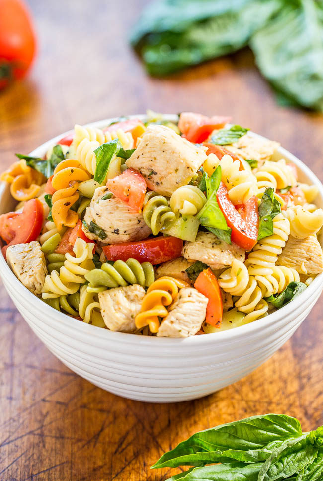 Italian Chicken Pasta Salad: Easy, Ready in 20 Minutes, and Healthy! Brimming with fresh flavors of juicy tomatoes, cucumber, basil, Parmesan, and tender chicken in a spicy lemon vinaigrette.
