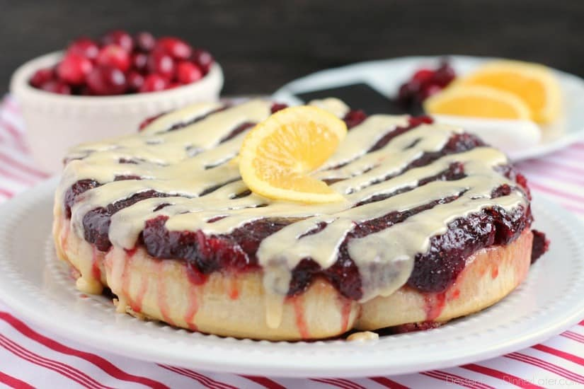 The frozen orange rolls are baked over a fresh blueberry sauce, reversed on a plate, and drizzled with a delicious orange cream cheese frosting for a Christmas breakfast worth sharing with family and friends.